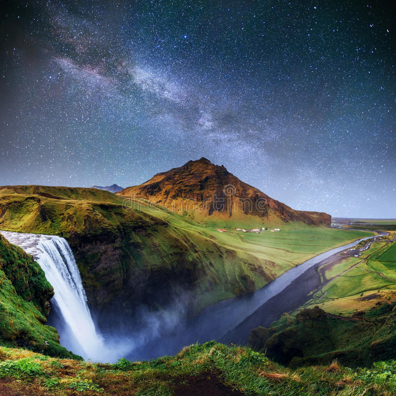 Beautiful waterfall. The starry sky and the Milky Way. Iceland. stock image