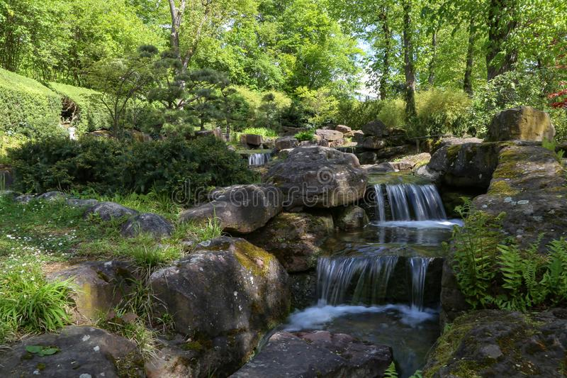 Beautiful waterfalls in the City Park in spring royalty free stock photos