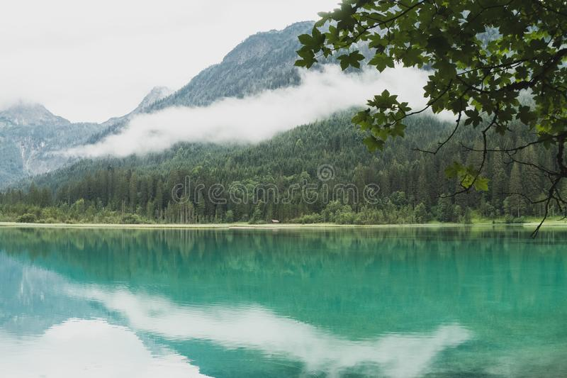 Beautiful waterscape on lake Jagersee on a foggy sommersday stock photography