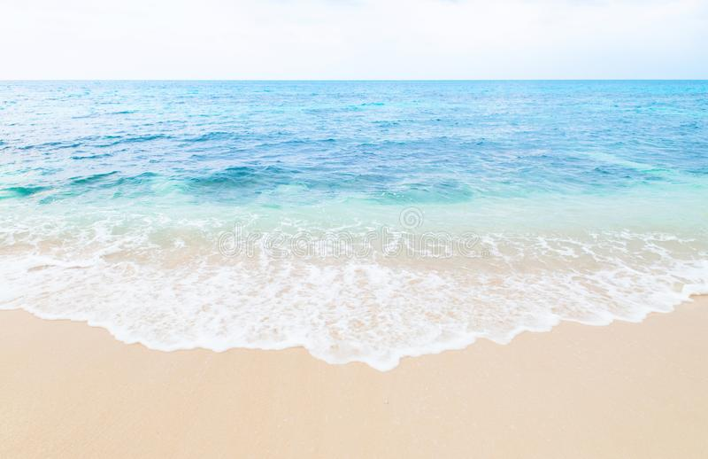 Beautiful wave touch sand beach of Miyako island, Okinawa, Japan. Beautiful wave from blue turqouise sea touch sand beach of Miyako island, Okinawa, Japan royalty free stock photo