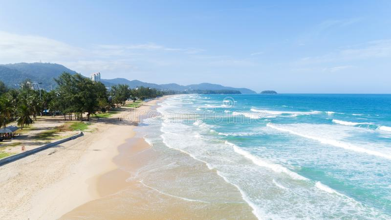 Beautiful wave crashing on sandy shore at karon beach in phuket. Thailand,aerial view drone shot royalty free stock image