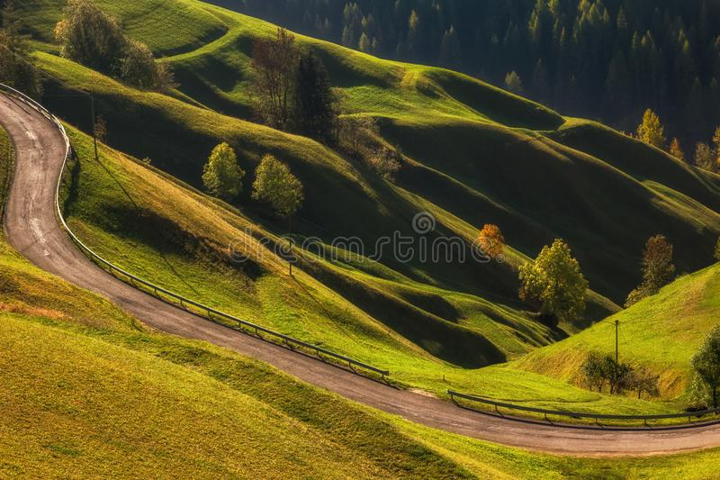Beautiful wavy meadow landscape nearby La Valle La Val, Trentino Alto Adidge, Italy. stock photo