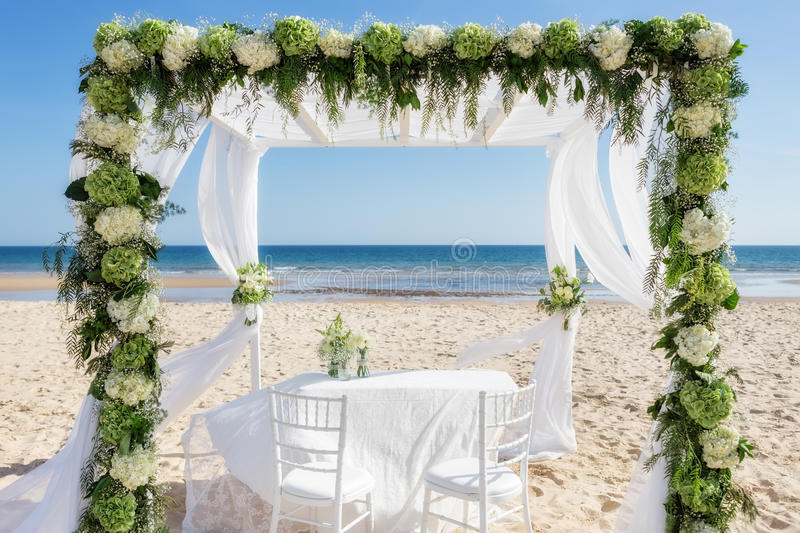 Beautiful wedding arch on the beach royalty free stock photography