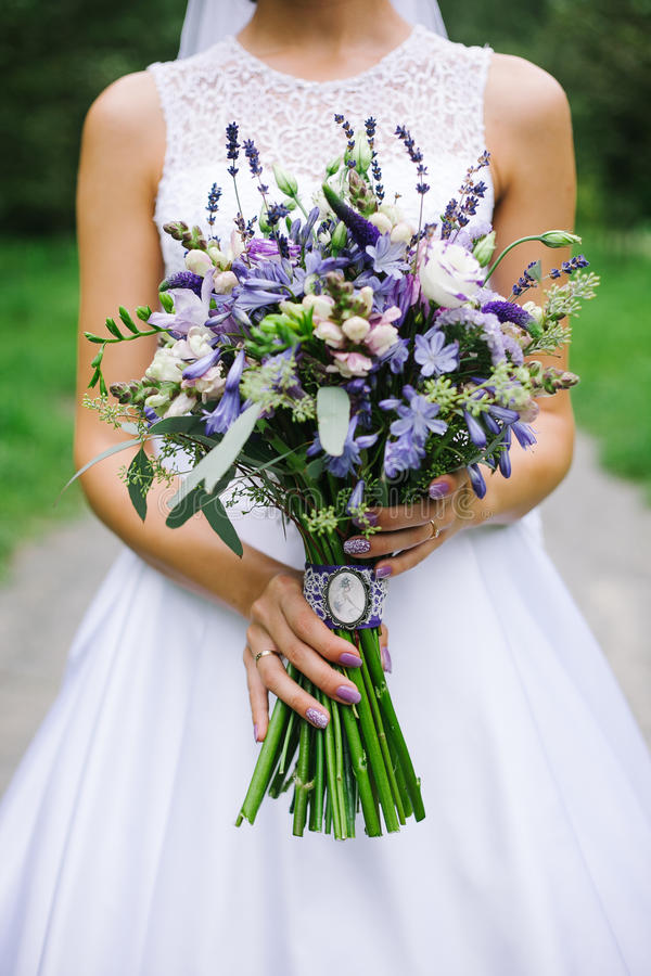 Beautiful wedding bouqet in hands royalty free stock image