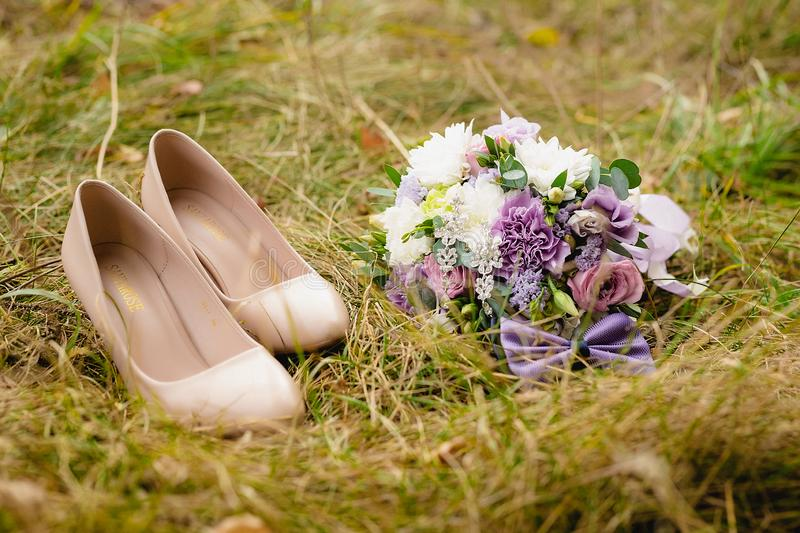 Beautiful wedding bouquet with bow-tie on the grass. Wedding composition stock images