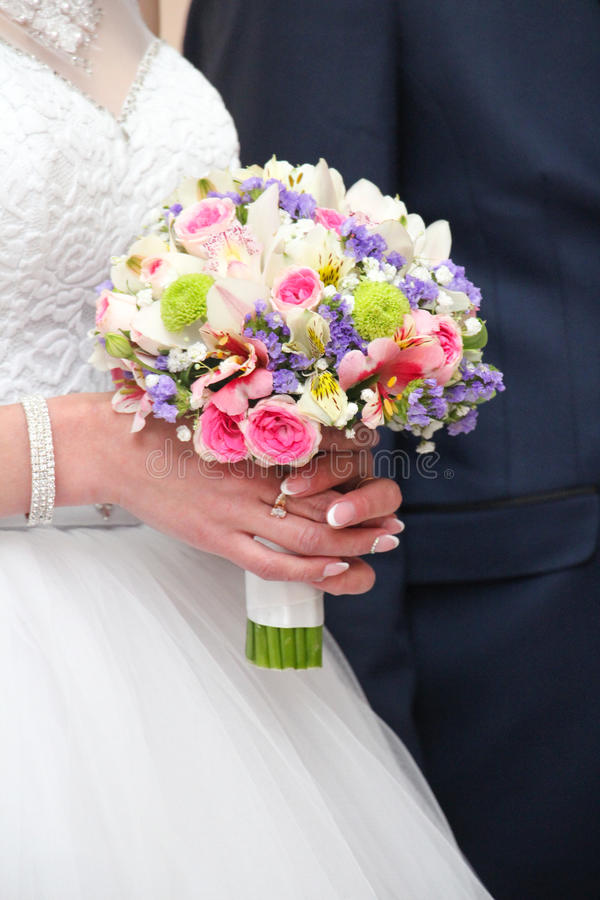 Beautiful wedding bouquet in brides stock image