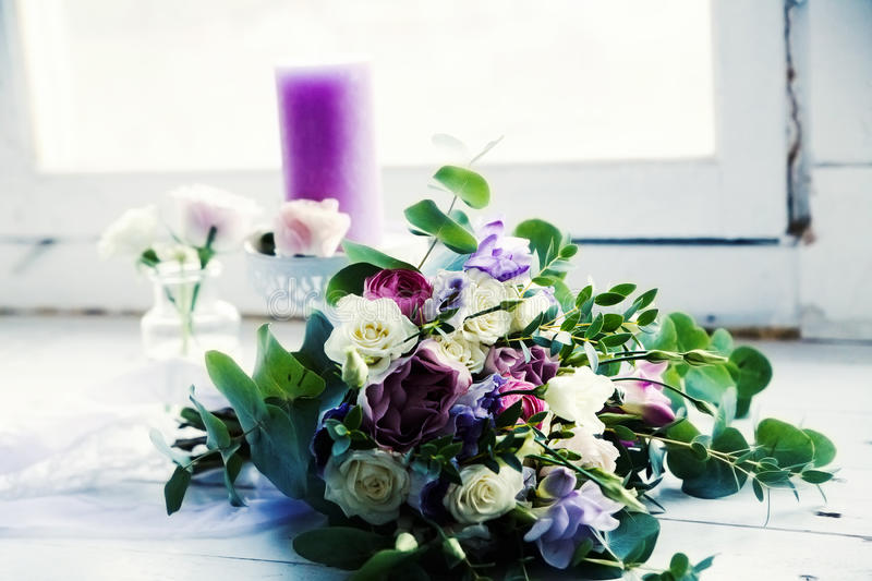 Beautiful wedding bouquet with candles on windowsill stock photography