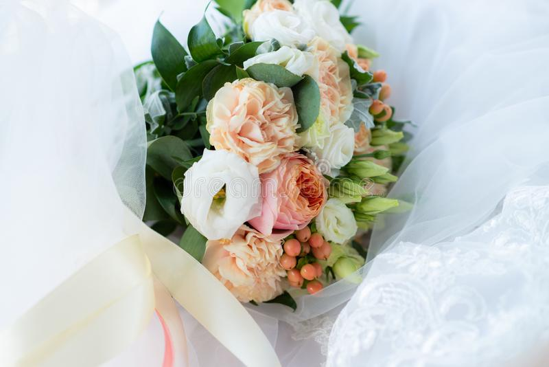 Beautiful wedding bouquet decorated with white and pink roses, bridal flowers of pastel colour royalty free stock photos