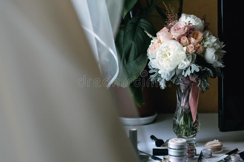 Beautiful wedding bouquet in a glass vase. royalty free stock photography