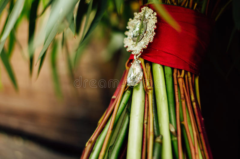 Beautiful wedding bouquet near the tree royalty free stock photography