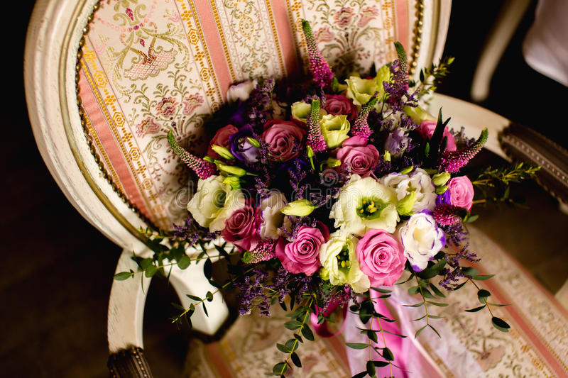 Beautiful wedding bouquet on a vintage chair royalty free stock photos