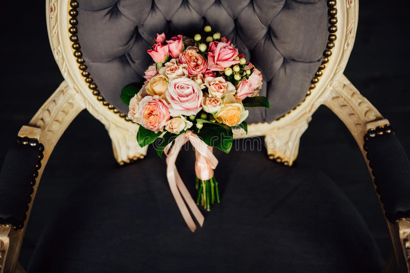 Beautiful wedding bouquet on a vintage chair stock photography