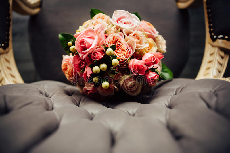 Beautiful wedding bouquet on a vintage chair stock photos