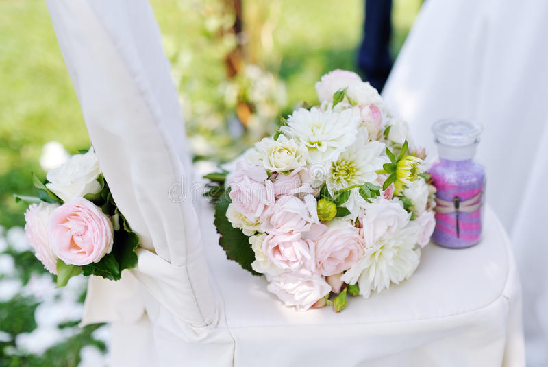 Beautiful Wedding Bouquet On A White Chair Stock Photos
