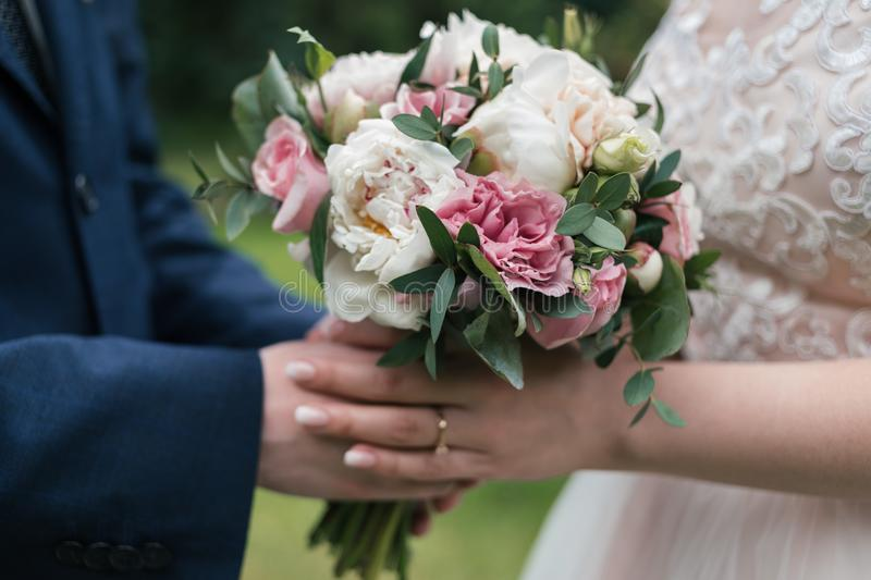 Beautiful wedding bouquet of white and pink peony in bride& x27;s. royalty free stock photos