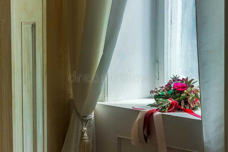 Beautiful wedding bouquet on the windowsill royalty free stock photos