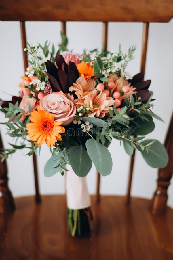 Beautiful wedding bunch of orange flowers stock photography