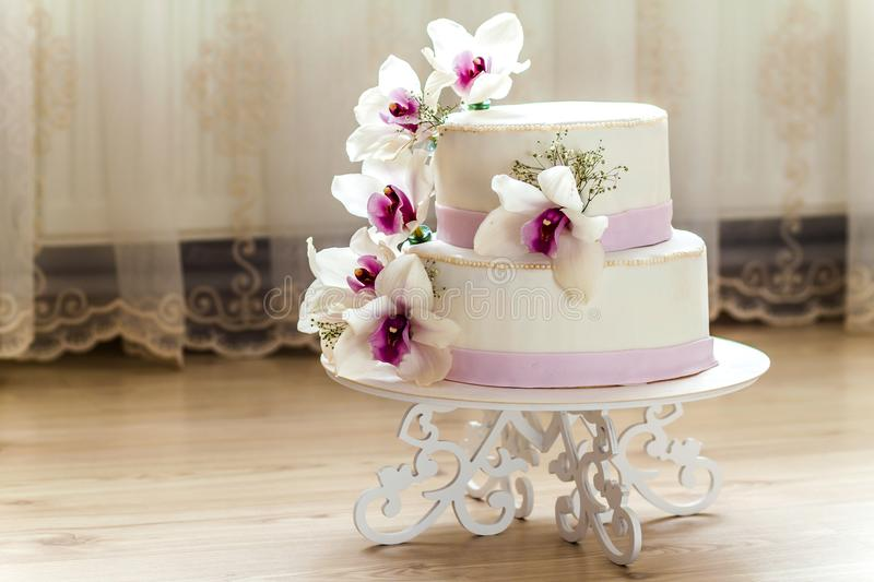 Beautiful wedding cake with flowers, close up of cake with blurr. Ed background, selective focus stock image