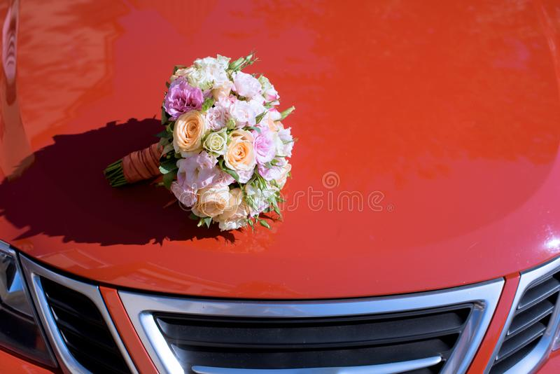 Beautiful wedding colorful bouquet and car for bride royalty free stock photo