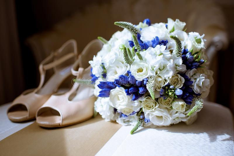 Beautiful wedding colorful bouquet and shoes for bride stock image