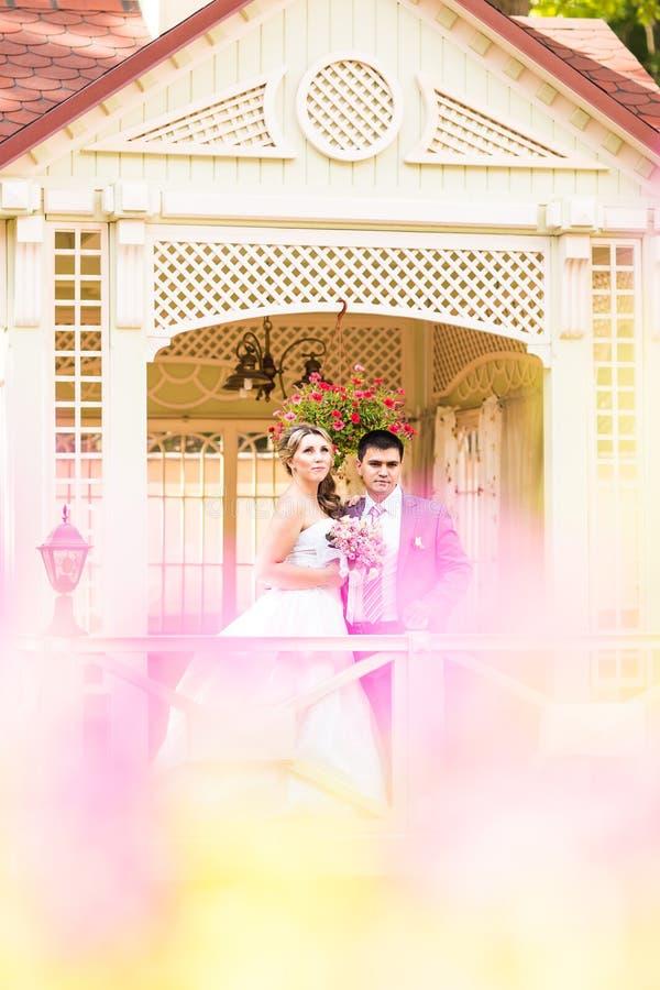 Beautiful wedding couple is enjoying wedding stock image