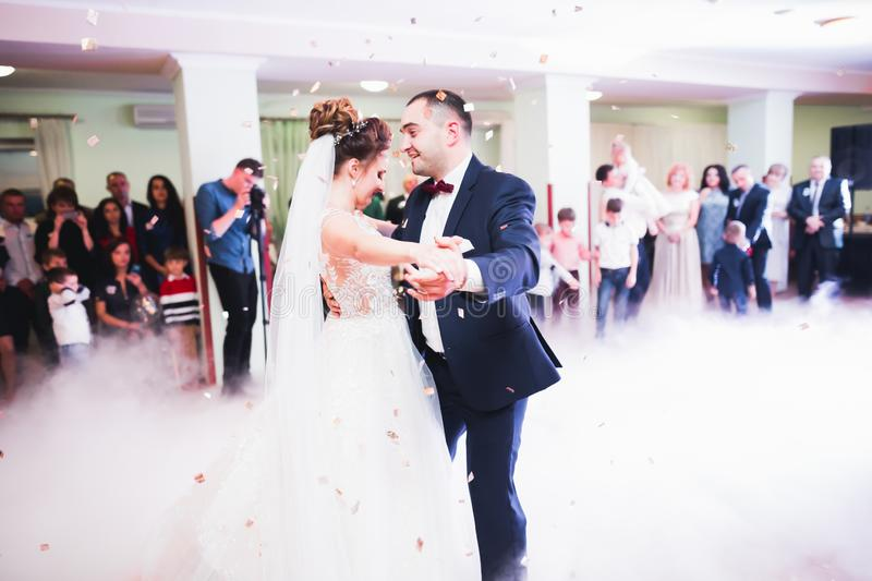 Beautiful wedding couple just married and dancing their first dance stock photo