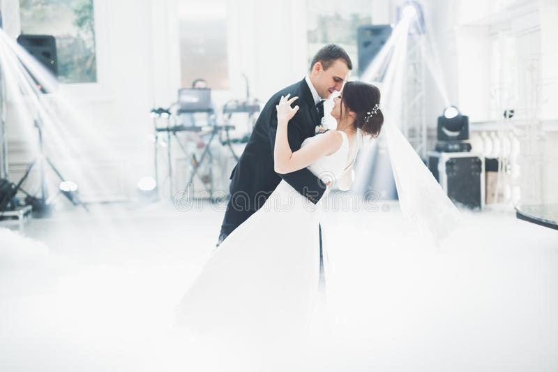 Beautiful wedding couple just married and dancing their first dance stock image