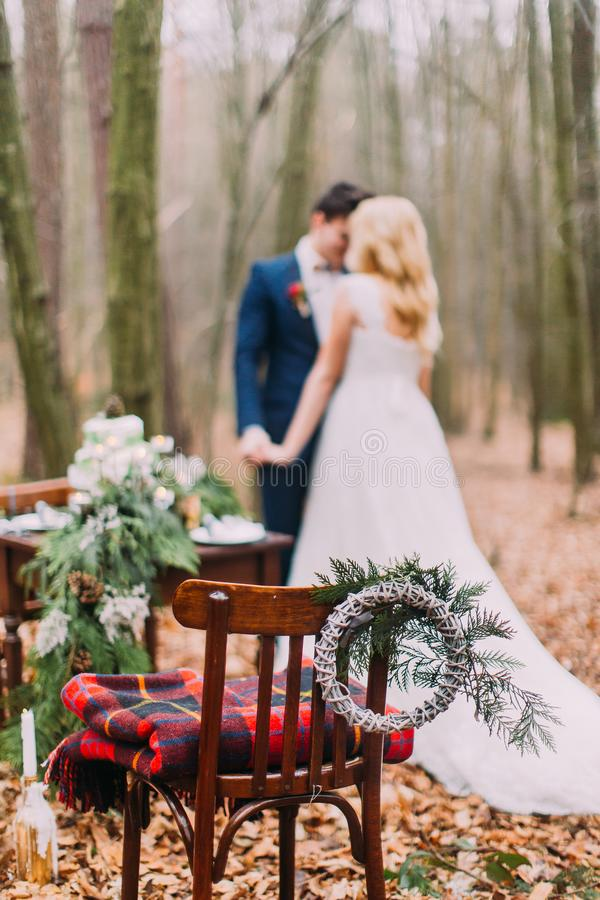 Beautiful wedding couple posing near the vintage table in autumn forest stock photography