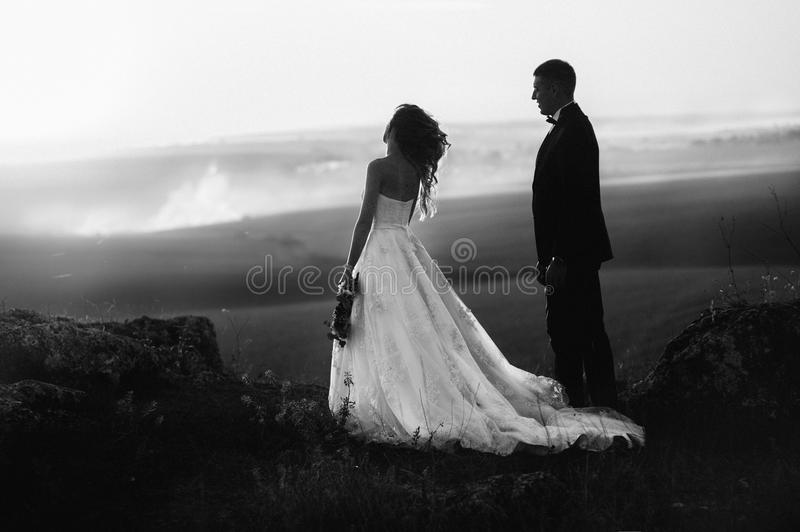 Beautiful wedding day, love on the sunset. Black and white photo stock photo