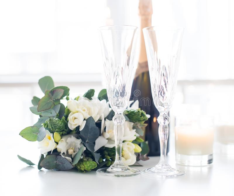 Beautiful wedding decoration with champagne and flowers, elegant stock photography