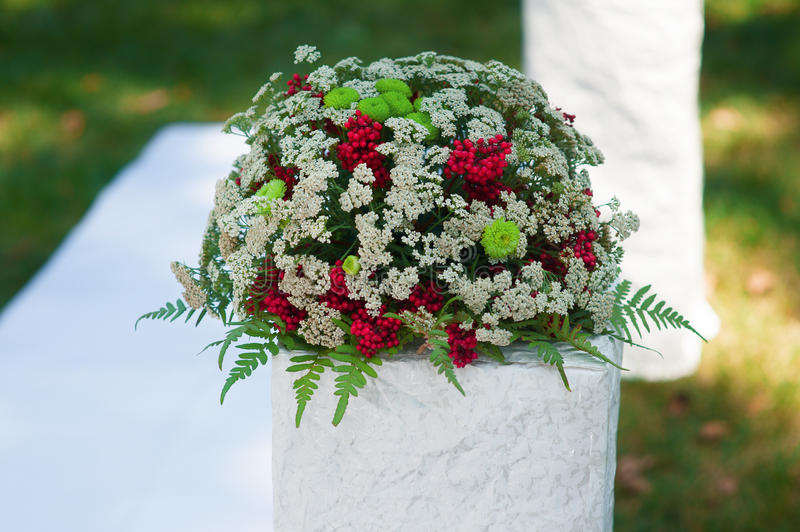 Beautiful wedding decorations of flowers at ceremony in the Park. Beautiful wedding decorations of flowers at the wedding ceremony in the Park stock image