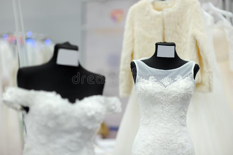 Beautiful wedding dresses on a mannequin in a shop or at an exhibition stock photos