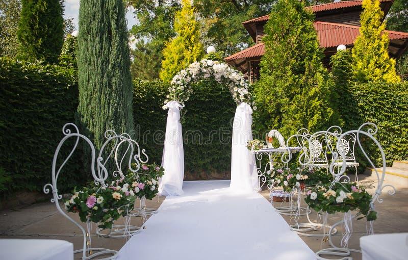 Beautiful wedding flower arrangement of seats along the aisle royalty free stock photography