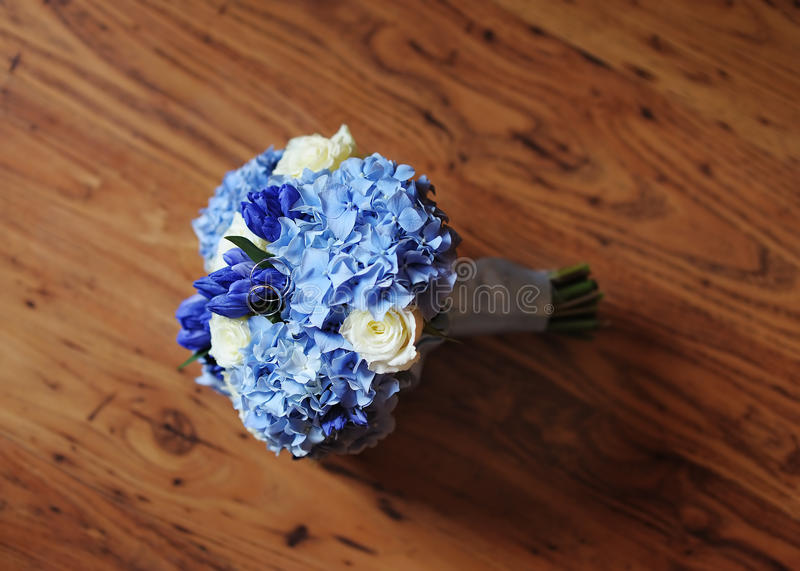 Beautiful wedding flowers bouquet and wedding rings royalty free stock photo