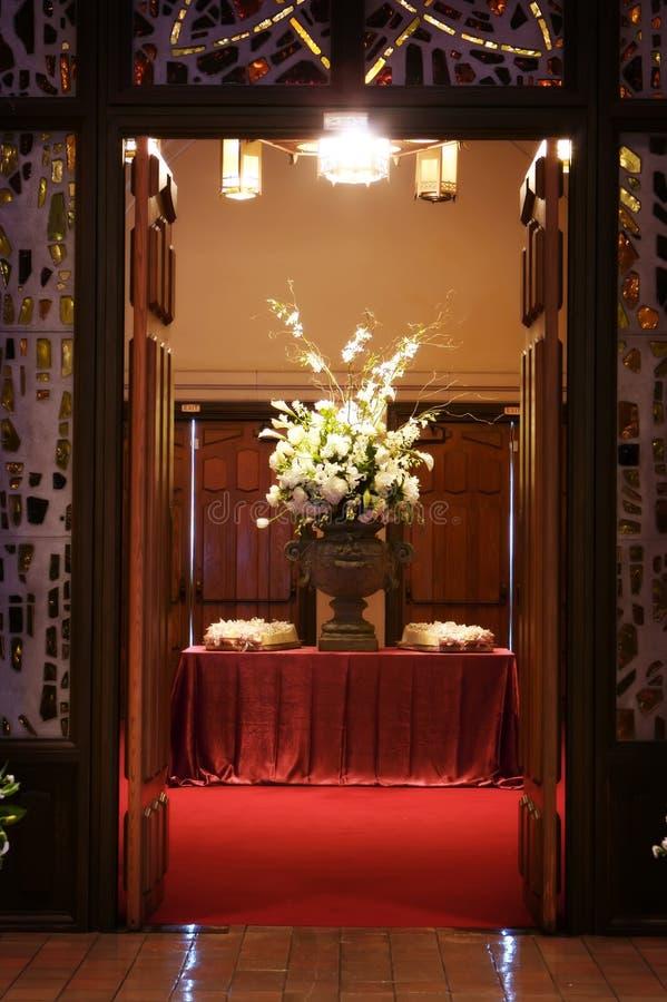 Beautiful wedding flowers inside a church stock photo