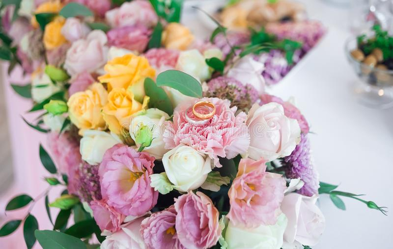 Beautiful wedding flowers and rings. Event decor. Rings of newlyweds royalty free stock images