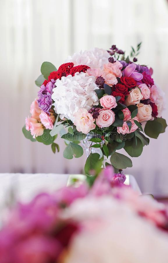 Beautiful wedding flowers on the table royalty free stock image