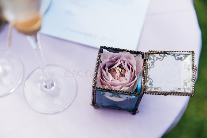 Beautiful wedding glass with champagne. And rings on table royalty free stock images