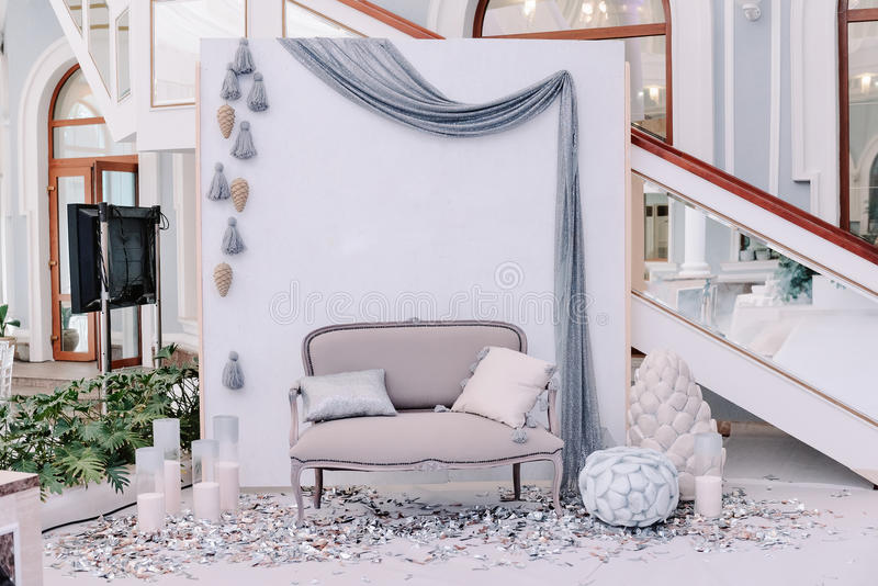 Beautiful wedding photo zone with small sofa royalty free stock photography