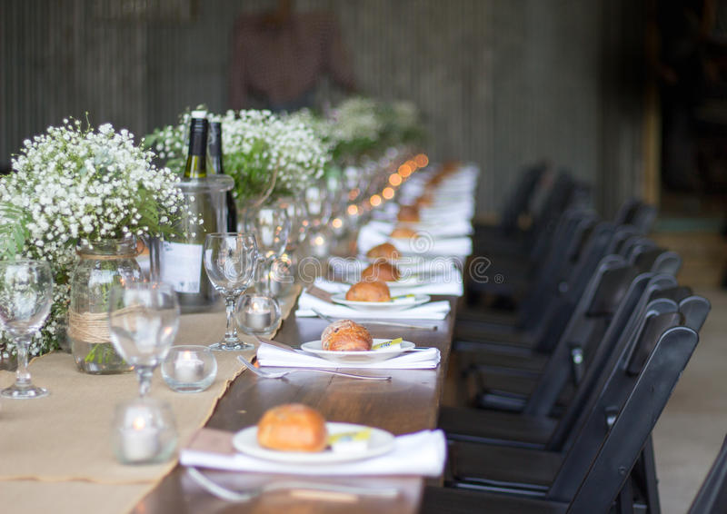 Beautiful wedding table with flowers, bread rolls, and wine stock images