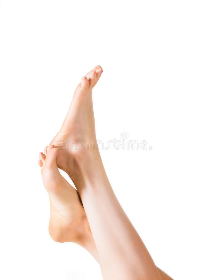 Beautiful well-groomed female a foot and a heel isolated on a white background. royalty free stock photo