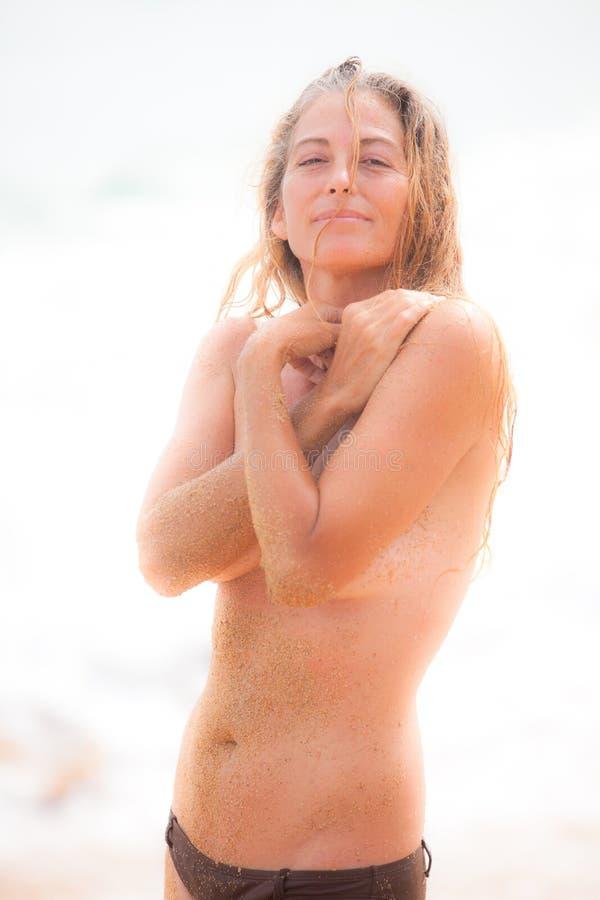 Beautiful Wet Sandy Woman stock photo