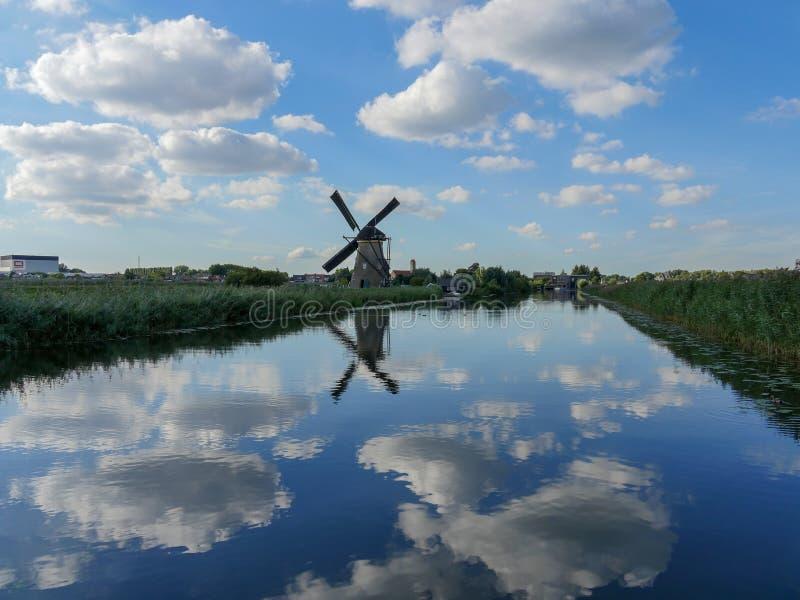 Old Dutch Windmill in beautiful shot. In the beautiful wetlands around Dordrecht, you will find the windmills of Kinderdijk. Nineteen beautiful windmills, built royalty free stock photos