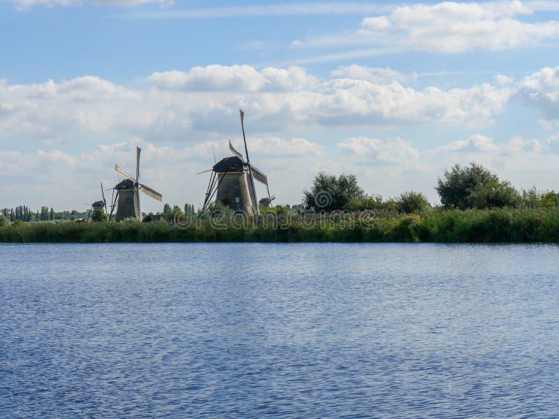 Old Dutch Windmill in beautiful shot. In the beautiful wetlands around Dordrecht, you will find the windmills of Kinderdijk. Nineteen beautiful windmills, built stock photo