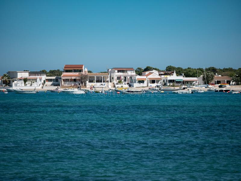 Beautiful white beach houses and boats, Olhao, Algarve, Portugal stock photo