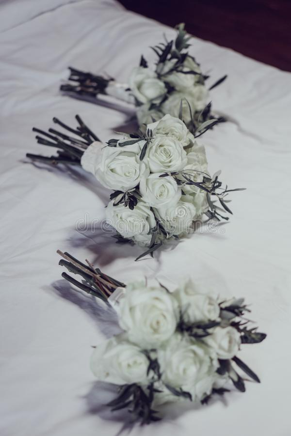 Beautiful white bouquets of wedding flowers. Ready for the bridesmaids to use for the ceremony stock images
