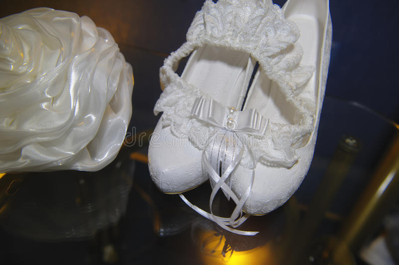 Beautiful white bride's handbag and shoes on the table royalty free stock images