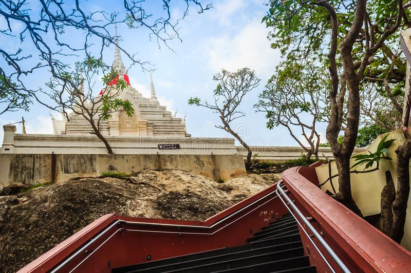 Beautiful white buddhist pavilion on the hilltop with blue sky background at Wat Phraputthachai temple, Saraburi, Thailand. This t. Emple is public for entry and stock photography