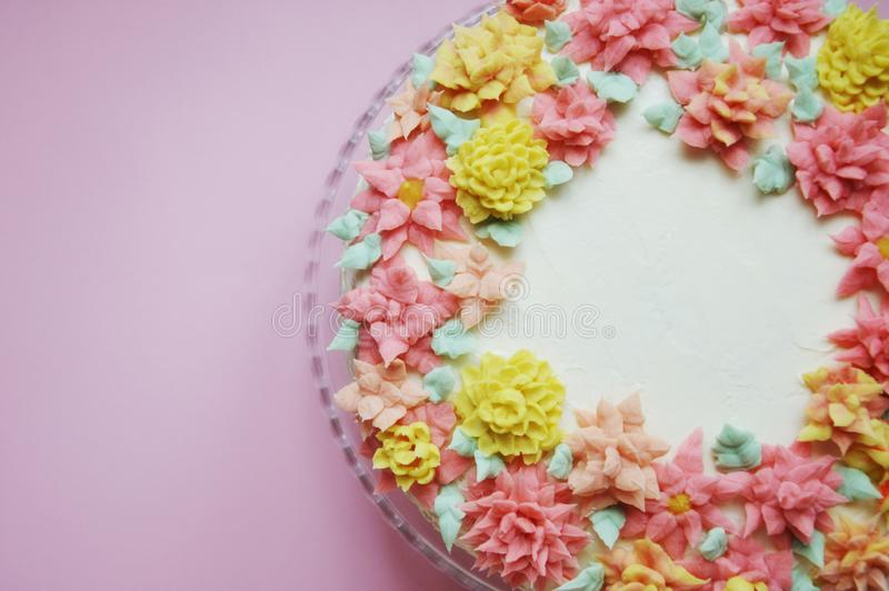 Cake with cream flowers on a light background. stock photography
