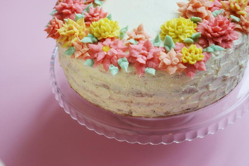 Cake with cream flowers on a light background. stock photo